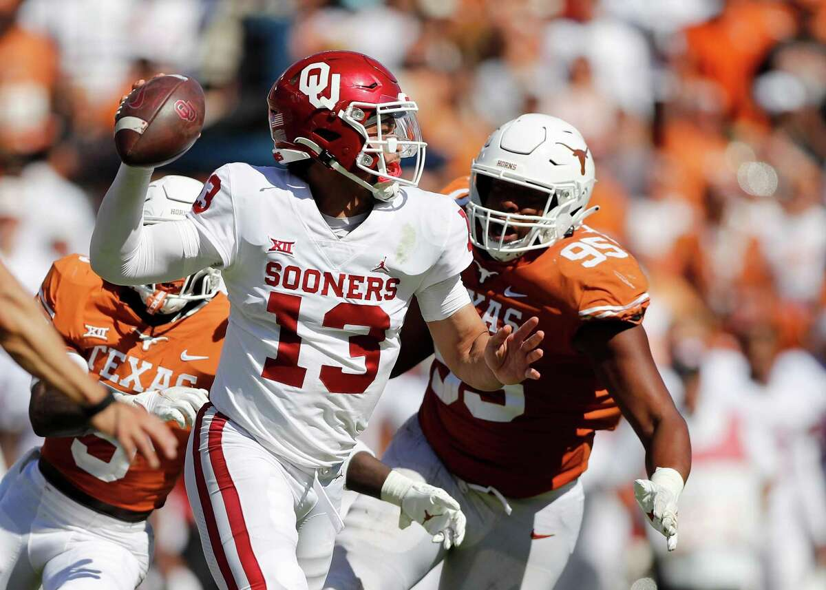 DALLAS, TEXAS - OCTOBER 09: Caleb Williams #13 of the Oklahoma Sooners looks to pass in the fourth quarter against the Texas Longhorns during the 2021 AT&T Red River Showdown at Cotton Bowl on October 09, 2021 in Dallas, Texas. (Photo by Tim Warner/Getty Images)