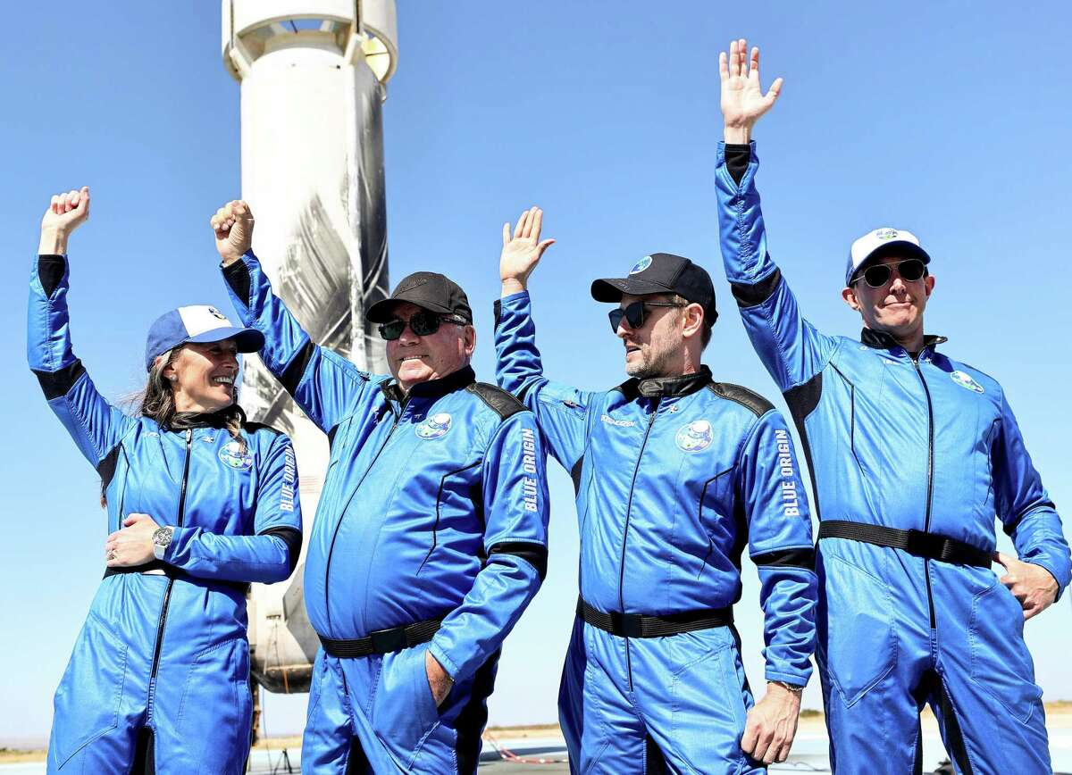 VAN HORN, TEXAS - OCTOBER 13: (L-R) Blue Origins vice president of mission and flight operations Audrey Powers, Star Trek actor William Shatner, Planet Labs co-founder Chris Boshuizen and Medidata Solutions co-founder Glen de Vries wave during a media availability on the landing pad of Blue Origin's New Shepard after they flew into space on October 13, 2021 near Van Horn, Texas. Shatner became the oldest person to fly into space on the ten minute flight. They flew aboard mission NS-18, the second human spaceflight for the company which is owned by Amazon founder Jeff Bezos. (Photo by Mario Tama/Getty Images)