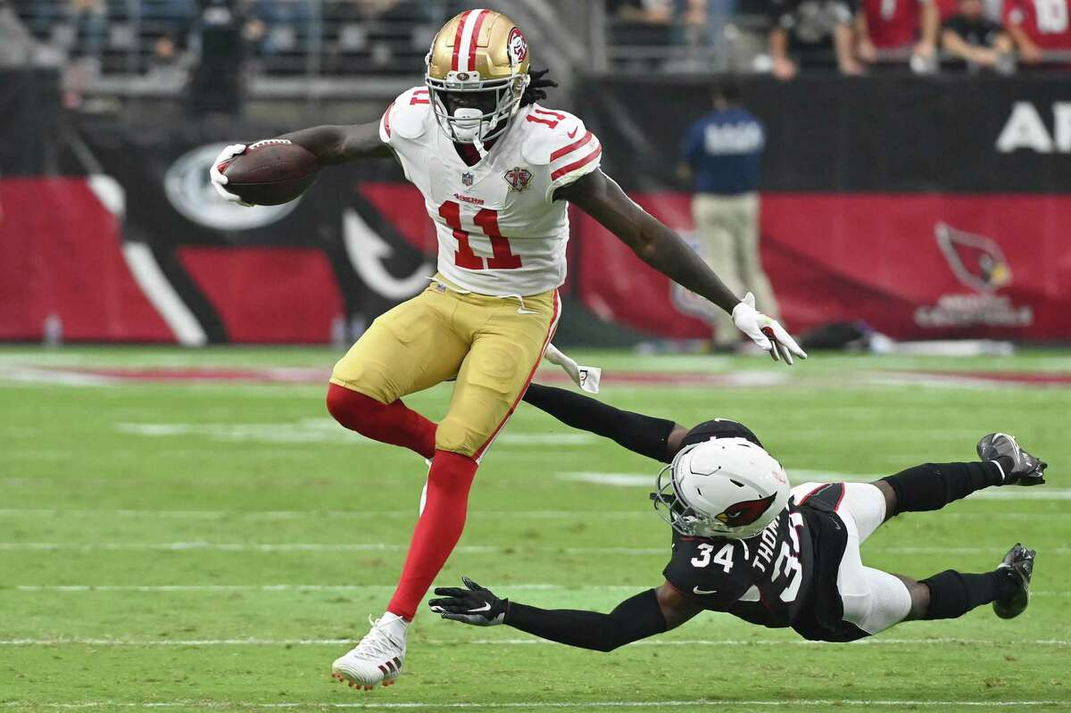 GLENDALE, ARIZONA - OCTOBER 10: Brandon Aiyuk #11 of the San Francisco 49ers breaks a tackle from Jalen Thompson #34 of the Arizona Cardinals during the fourth quarter at State Farm Stadium on October 10, 2021 in Glendale, Arizona. (Photo by Norm Hall/Getty Images)