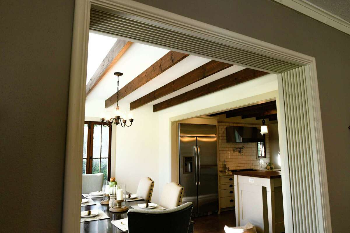 Among the details Gilbert and Liliana Moreno retained in their Monticello Park home are the rows of half rounds running along the inside of the case opening between the dining and living rooms.