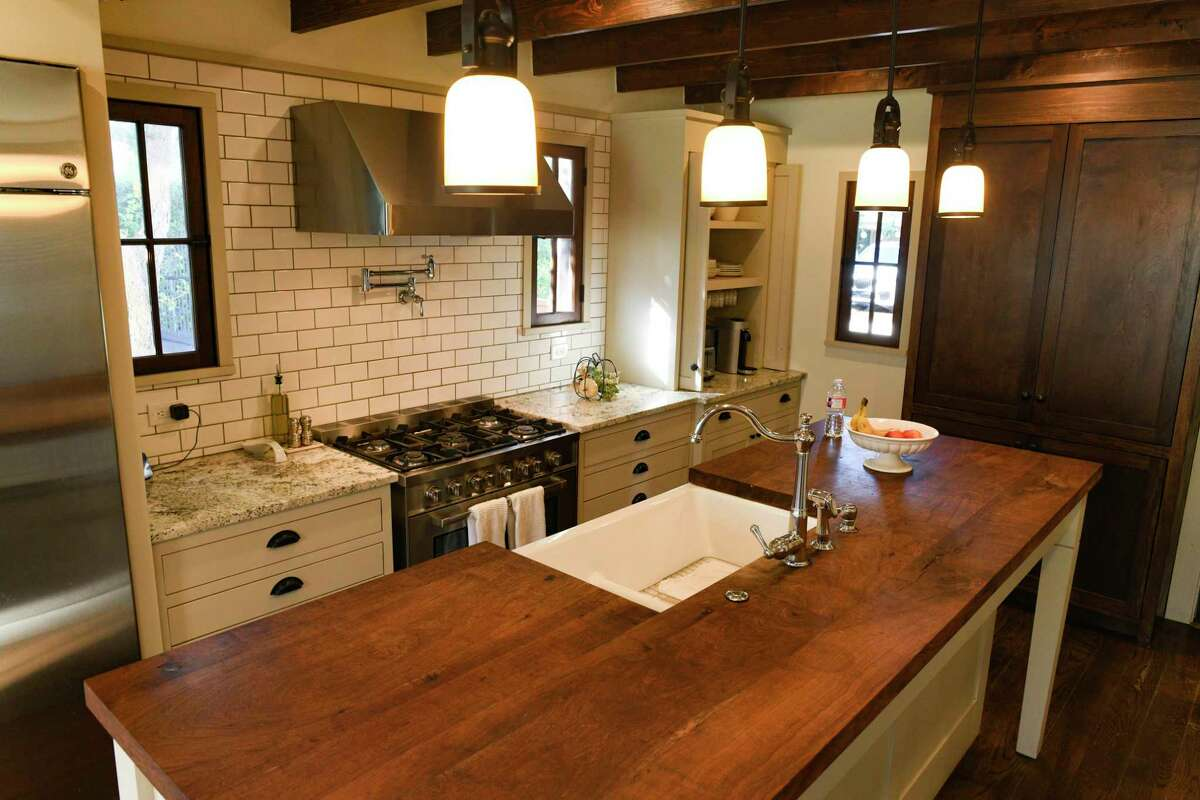 The single biggest project they undertook was the expansion and renovation of the kitchen, a project that took four months. The island is topped with mesquite wood butcher block.