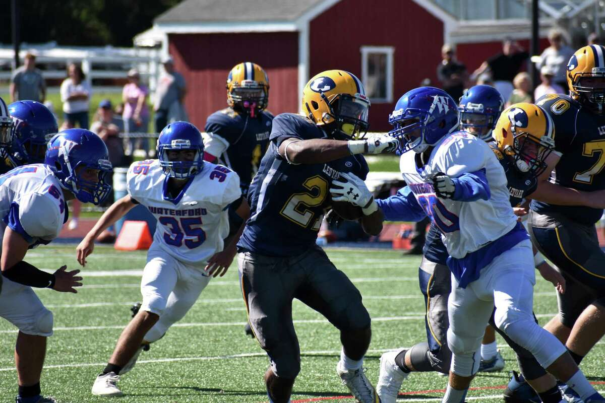 Ledyard's Ryan Outlow breaks a tackle during a football game between Ledyard and Waterford at Bill Mignault Field, Ledyard on Saturday, Sept. 25, 2021.