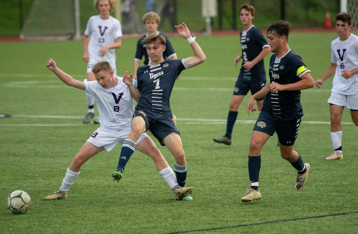 Voorheesville's Jake Johnson, left, battles for the ball with Cohoes' Zack Halloran during the Colonial Council tournament boys' soccer game on Wednesday, Oct, 13, 2021 in Troy, N.Y.