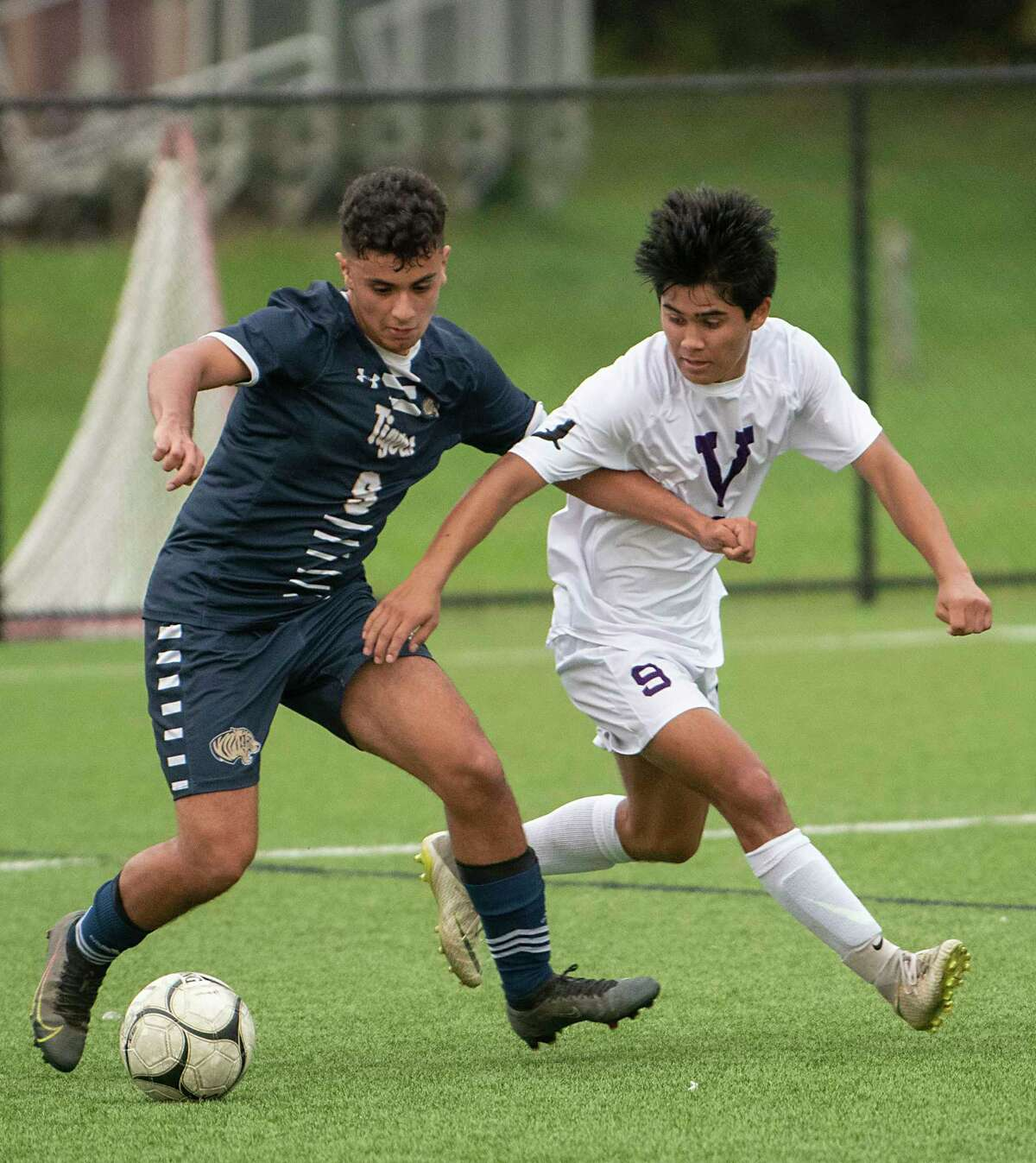 Cohoes' Johnny Martinez-Peraza, left, battles for the ball with Voorheesville's DylanEnslinn during the Colonial Council tournament boys' soccer game on Wednesday, Oct, 13, 2021 in Troy, N.Y.