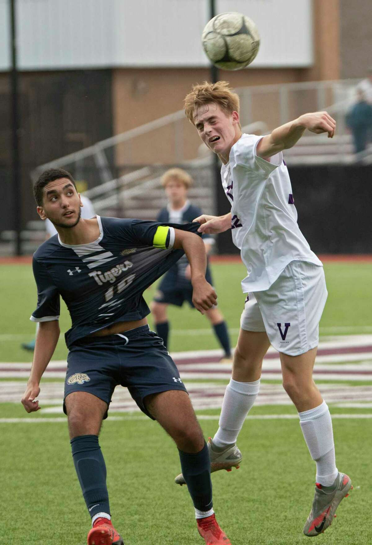 Cohoes' Jad Essoulaimani, left, battles for the ball with Voorheesville's Daniel Wittman during the Colonial Council tournament boys' soccer game on Wednesday, Oct, 13, 2021 in Troy, N.Y.