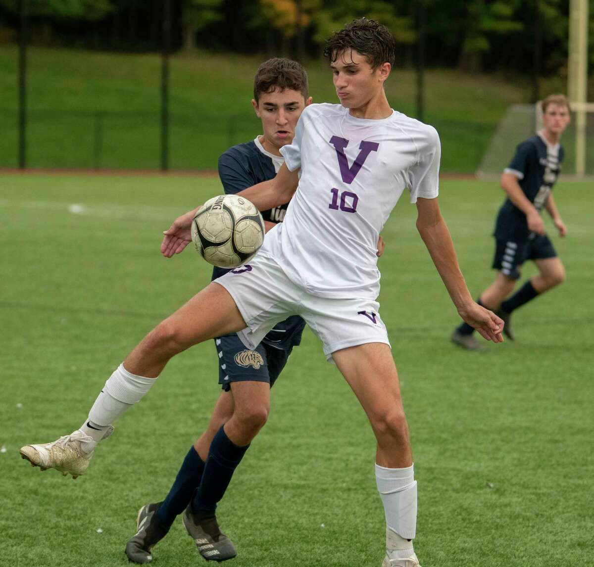 Cohoes' Kyle Smith, left, defends Voorheesville's Ryan McMillen during the Colonial Council tournament boys' soccer game on Wednesday, Oct, 13, 2021 in Troy, N.Y.