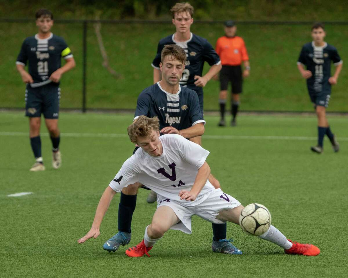 Cohoes' Luca Grestini battles for the ball with Voorheesville's Trevor Siemann, foreground, during the Colonial Council tournament boys' soccer game on Wednesday, Oct, 13, 2021 in Troy, N.Y.