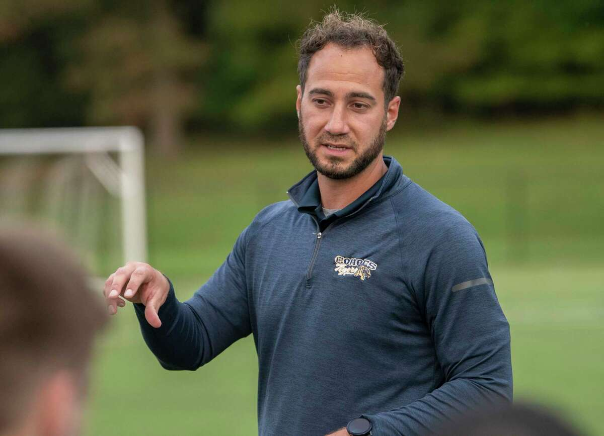 Cohoes head coach Nick Izzo talks to his team during the Colonial Council tournament boys' soccer game against Voorheesville on Wednesday, Oct, 13, 2021 in Troy, N.Y.