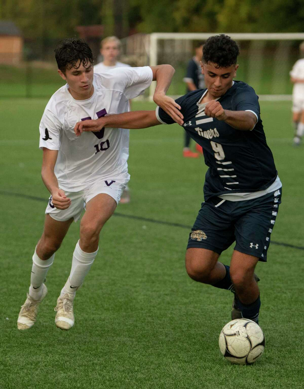 Voorheesville's Ryan McMillen, left, battles for the ball with Cohoes' Johnny Martinez-Peraza during the Colonial Council tournament boys' soccer game on Wednesday, Oct, 13, 2021 in Troy, N.Y.