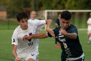 Voorheesville's Ryan McMillen, left, battles for the ball with Cohoes' Johnny Martinez-Perza during the Colonial Council tournament boys' soccer game on Wednesday, Oct, 13, 2021 in Troy, N.Y.