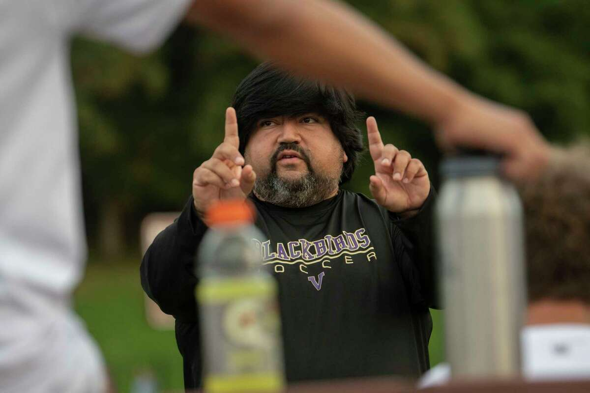 Voorheesville head coach Willie Sanchez talks to his team during the Colonial Council tournament boys' soccer game against Cohoes on Wednesday, Oct, 13, 2021 in Troy, N.Y.