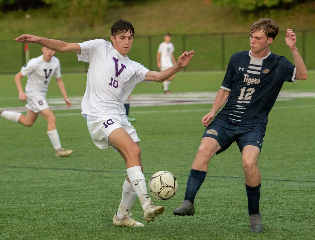 Voorheesville's Ryan McMillen, left, battles for the ball with Cohoes' Ryan Primeau during the Colonial Council tournament boys' soccer game on Wednesday, Oct, 13, 2021 in Troy, N.Y.