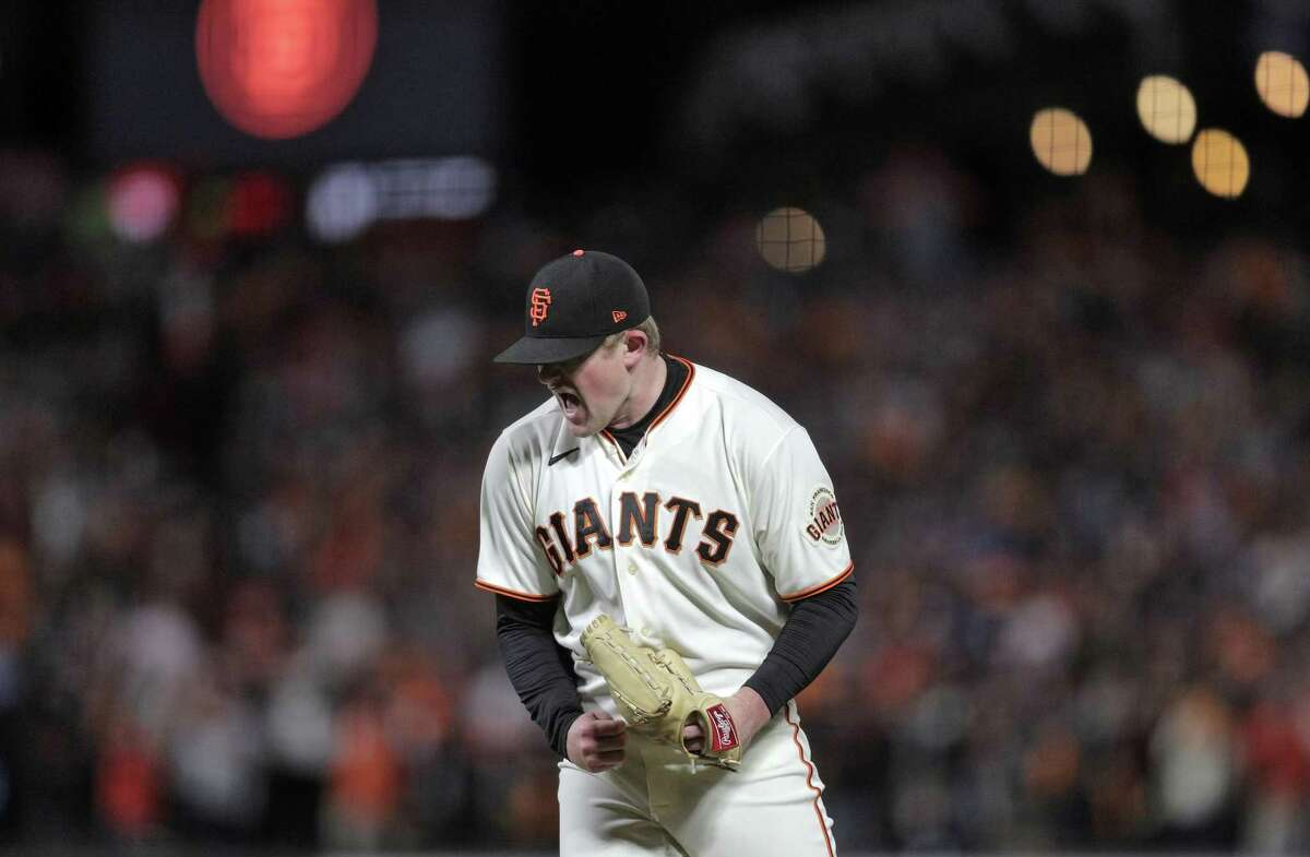 Logan Webb (62) reacts after striking out Cody Bellinger (35) to end the seventh inning as the San Francisco Giants played the Los Angeles Dodgers in Game 1 of the National League Division Series at Oracle Park in San Francisco, Calif., on Friday, October 8, 2021.