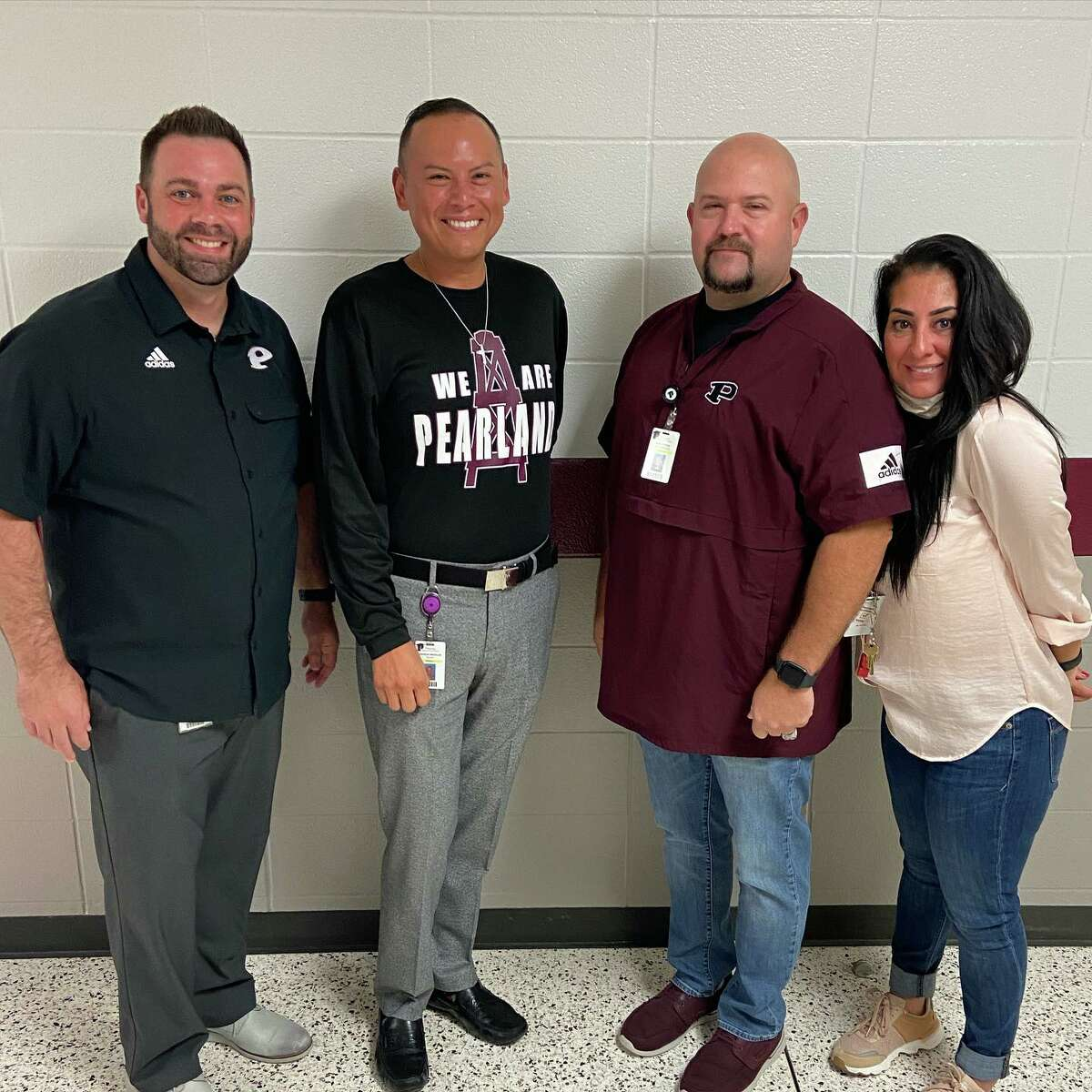 Pearland High School administrators congratulate Spanish teacher Cornelio Medellin, second from left, recent recipient of the Outstanding Hispanic Teacher award presented by the Brazoria County Chamber of Commerce. From left are Pearland High School Principal John Palombo, Medellin, Associate Principal Audie Johnson and Languages Other Than English department head Angelica Millan.