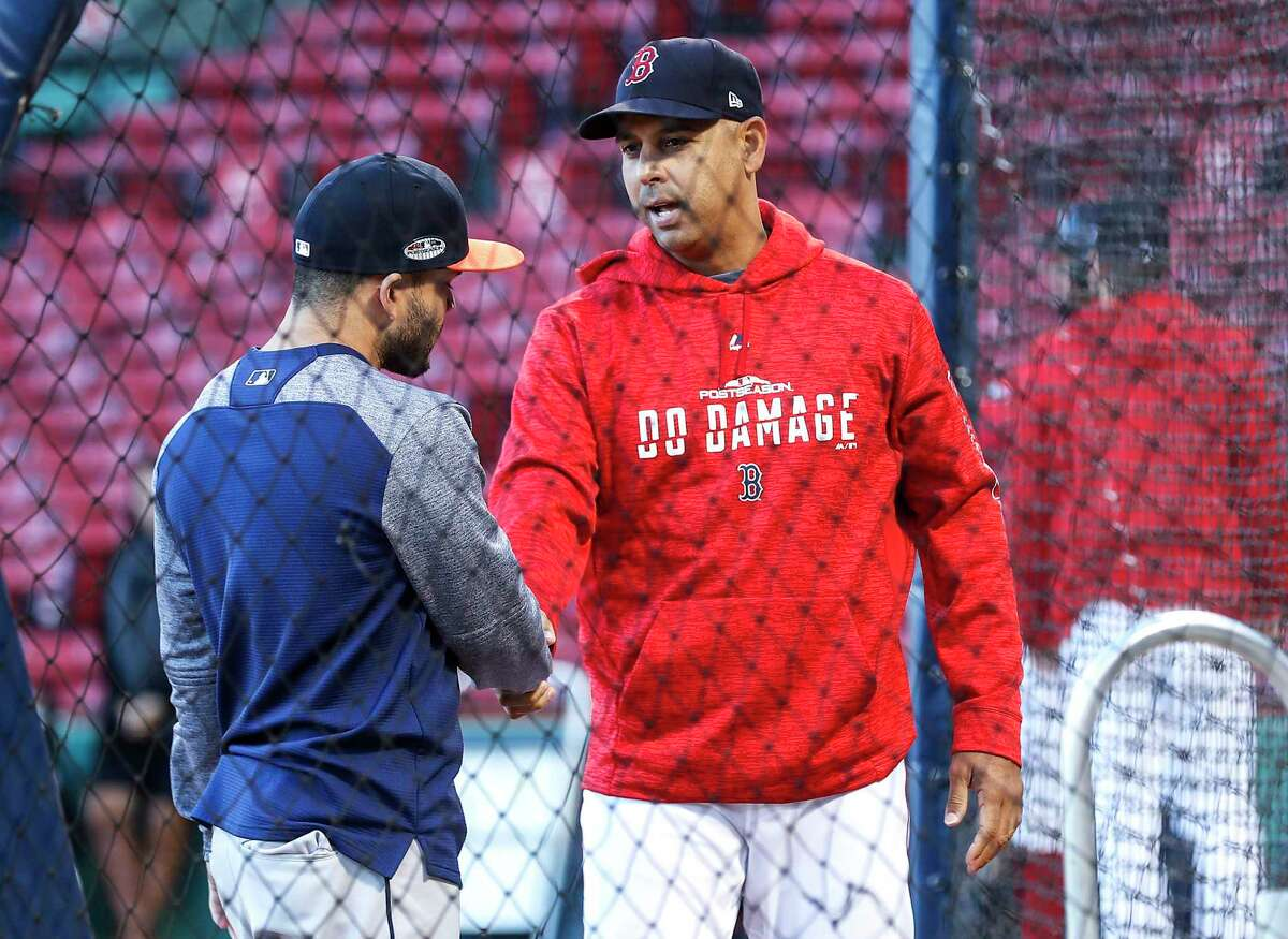 Second baseman Jose Altuve, left, talks with his former Astros bench coach, Red Sox manager Alex Cora, prior to Game 1 of the 2018 ALCS at Fenway Park. Boston won that series 4-1, but three years later, Houston gets a rematch.