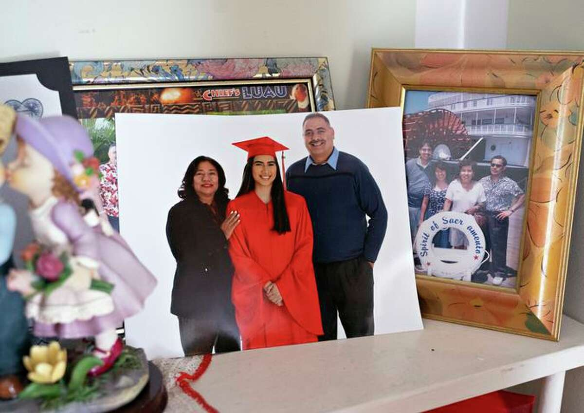 A photo of Jessica Ramos' high school graduation on the mantel of her childhood home in Oakland.