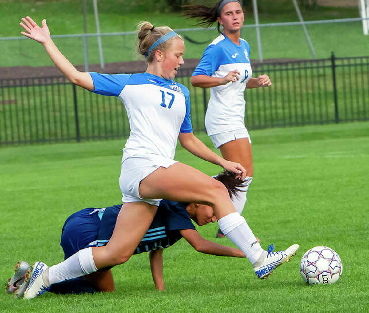 LCCC's Olivia Mouser (17), a freshman from Roxana, battles with St. Louis Community College's Sara Nishiyama during Wednesday's game at LCCC.