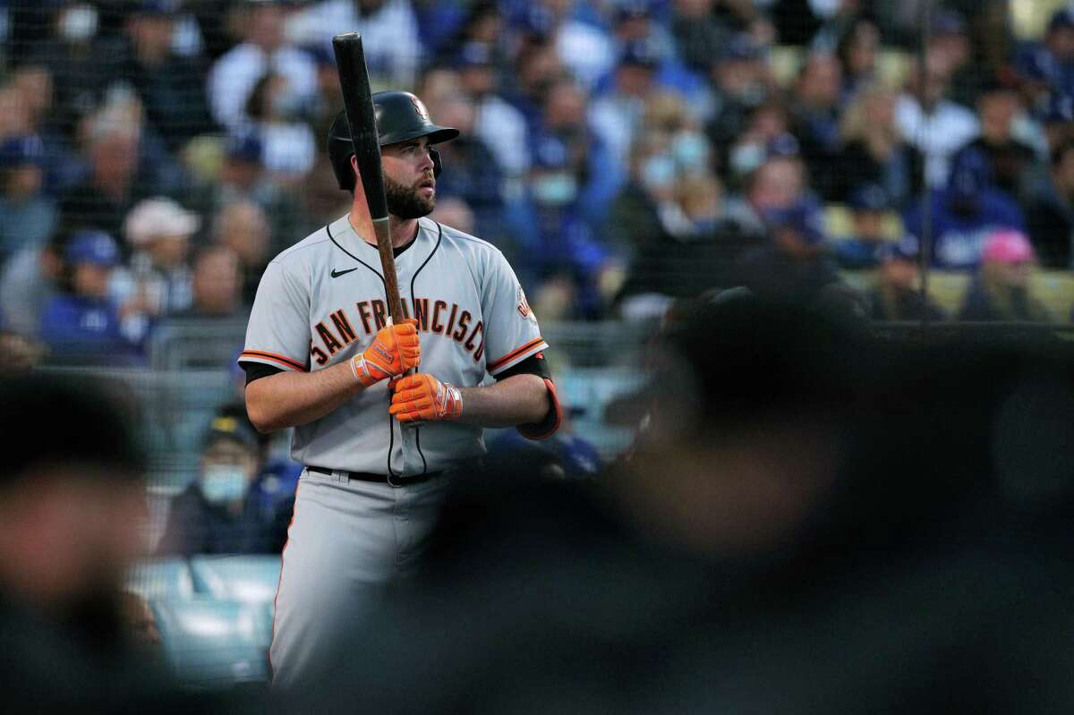 San Francisco Giants Darin Ruf (33) warms up in the on-deck circle during the top of the first inning as the San Francisco Giants played the Los Angeles Dodgers in Game 4 of the National League Division Series at Dodger Stadium in Los Angeles, Calif. on Tuesday, Oct. 12, 2021.