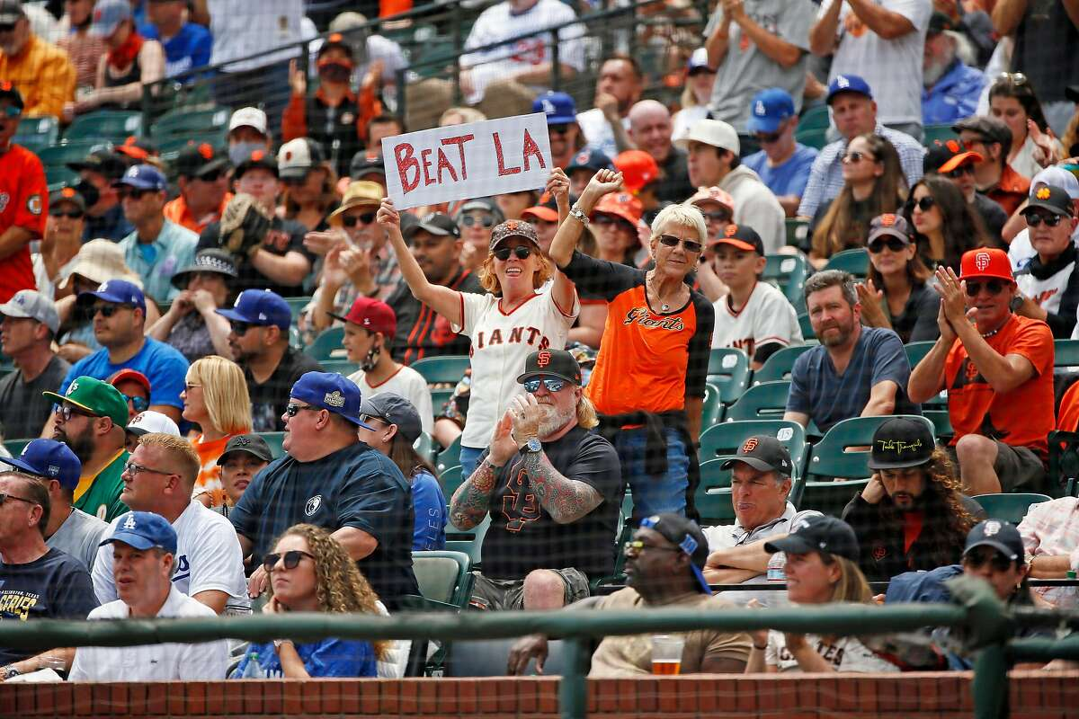Spectators cheer in the first inning during an MLB game against the Los Angeles Dodgers at Oracle Park, Thursday, July 29, 2021, in San Francisco, Calif.