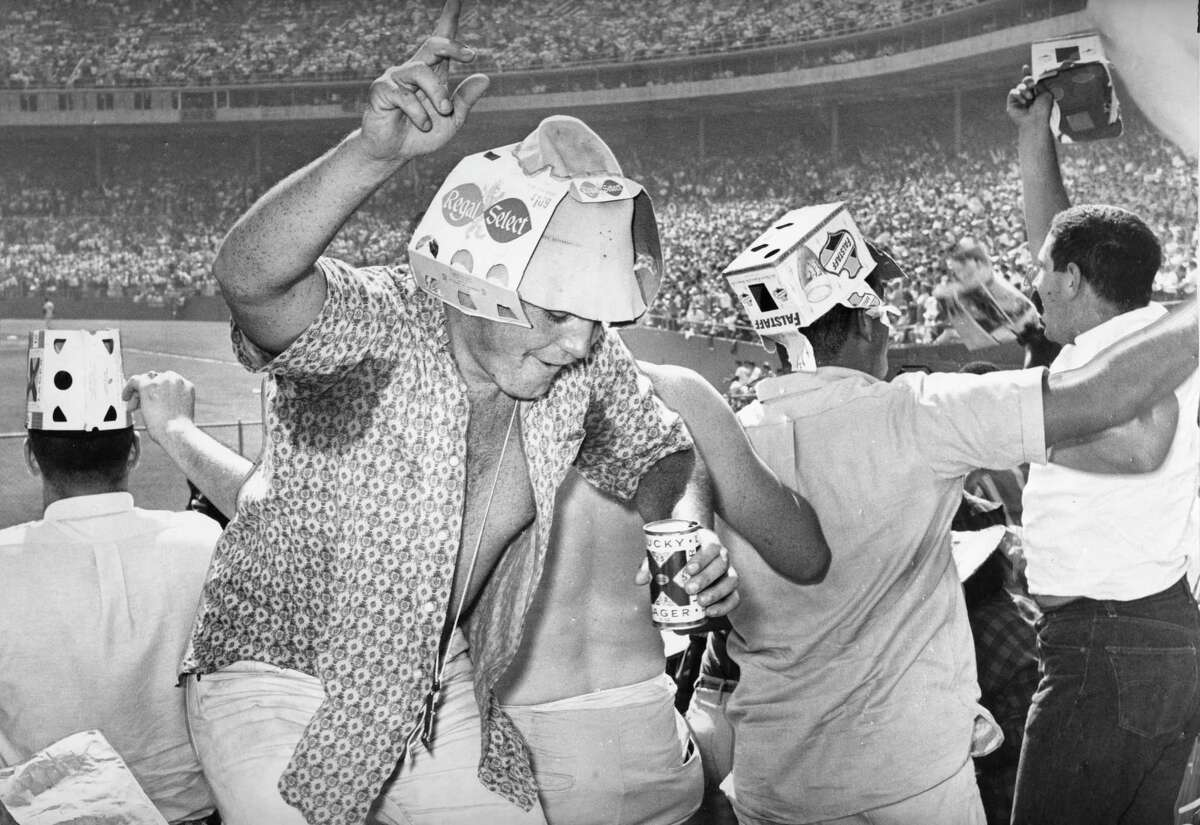 Oct. 1, 1962: Rowdy San Francisco Giants fans celebrate during a playoff game at Candlestick Park in 1962.