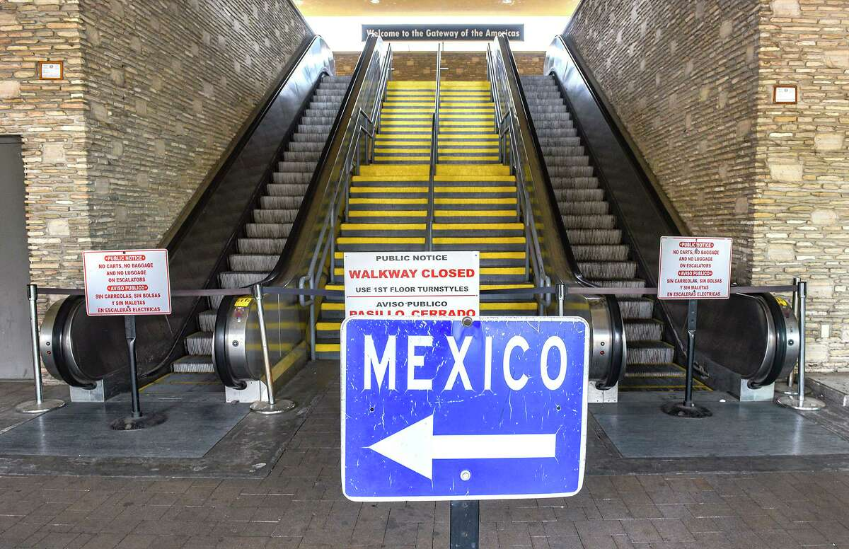 A view of an empty stairs and escalators for pedestrians crossing the Gateway to the Americas International Bridge in to Mexico, Friday, Mar. 20, 2020, in Laredo, TX.