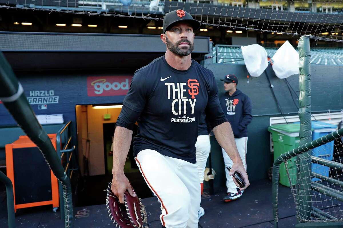 San Francisco Giants manager Gabe Kapler leaves the dugout during Wednesday's workout before Game 5 of the National League Division Series against the Dodgers.