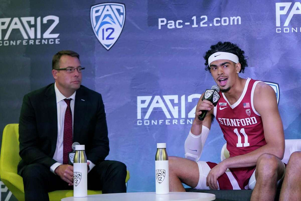 Stanford's Jaiden Delaire, right, speaks next to head coach Jerod Haase during the Pac-12 Conference NCAA college basketball media day Wednesday, Oct. 13, 2021, in San Francisco. (AP Photo/Jeff Chiu)