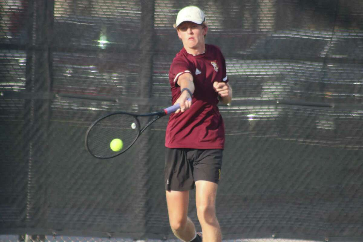 Deer Park's L.J. Godfrey returns a Summer Creek shot over the net during a doubles match Tuesday. Godfrey and his partner, Diego Cromeens, had to rally from behind to earn the victory in the bi-district contest.