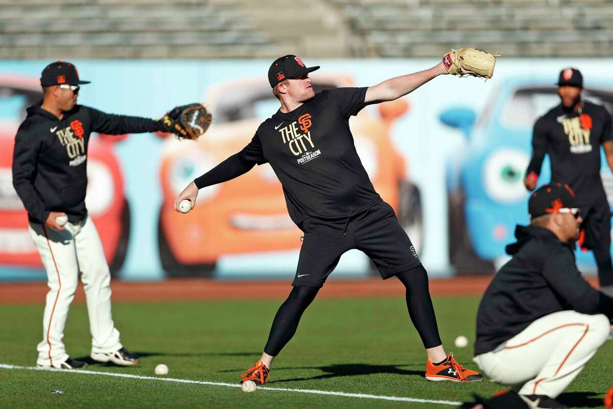 San Francisco Giants' Logan Webb plays long toss during workout before Game 5 of NLDS at Oracle Park in San Francisco, Calif., on Wednesday, October 13, 2021.