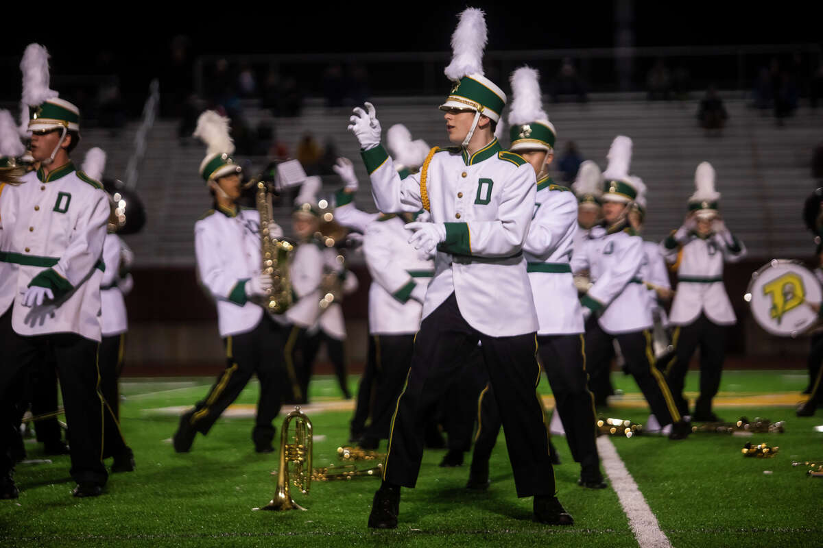 The H. H. Dow High School marching band performs during the Midland Marching Band Showcase Wednesday, Oct. 13, 2021 at Midland Community Stadium. (Katy Kildee/kkildee@mdn.net)