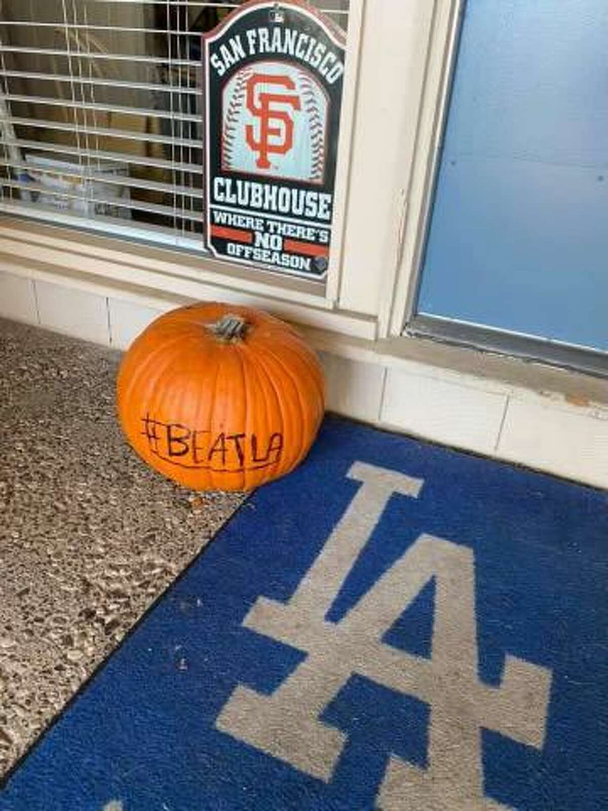 The doormat and pumpkin outside the Carmichael home of Carol Dahmen-Eckery and Kevin Eckery. Carol is a San Francisco Giants fan and Kevin a Los Angeles Dodgers fan.
