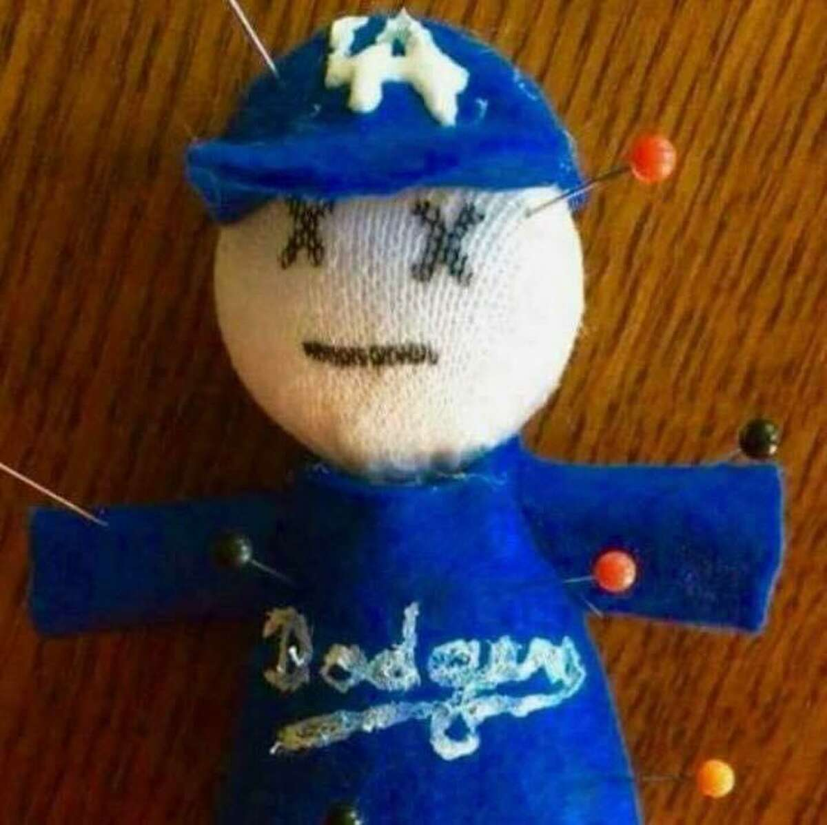A voodoo doll that is one of many good-luck charms owned by Carol Dahmen-Eckery to help the San Francisco Giants beat the Los Angeles Dodgers.