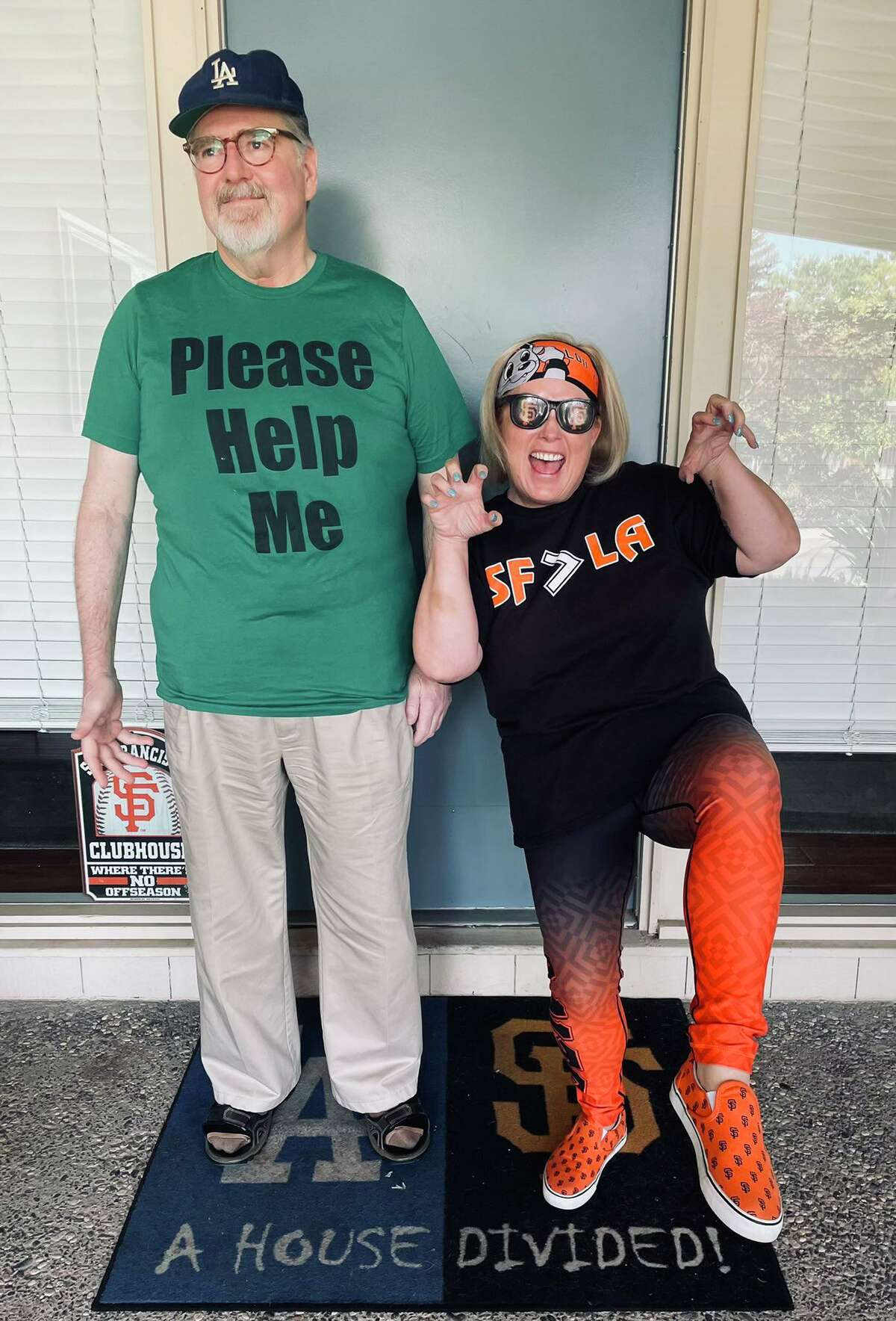Kevin Eckery and his wife Carol Dahmen-Eckery have a friendly rivalry going as their favorite teams, the Los Angeles Dodgers and San Francisco Giants, face off in the 2021 postseason.