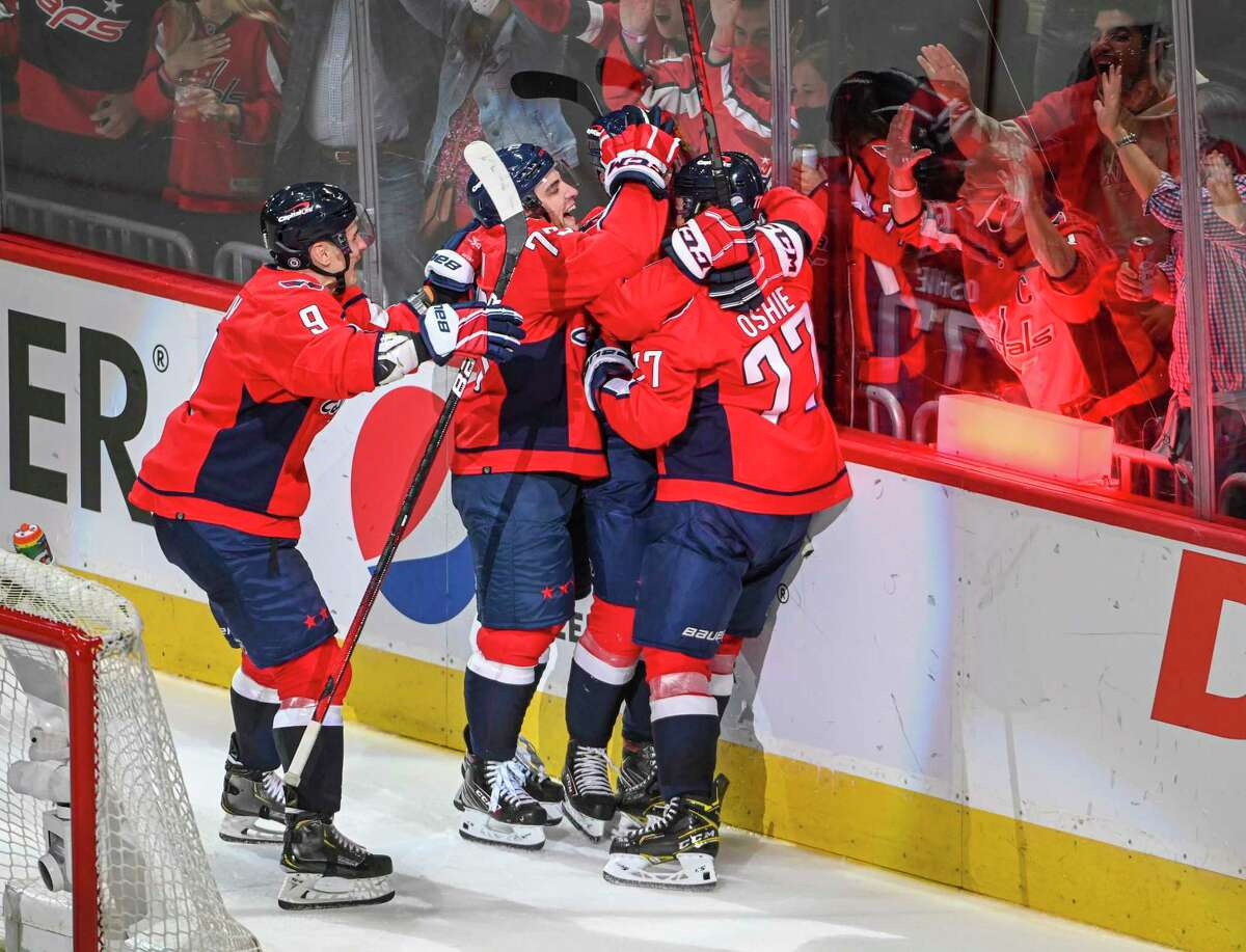 Washington Capitals center Hendrix Lapierre (29) celebrates his first NHL goal with the assist from right wing T.J. Oshie (77) during second period action against the New York Rangers at Capital One Arena on Oct. 13, 2021.