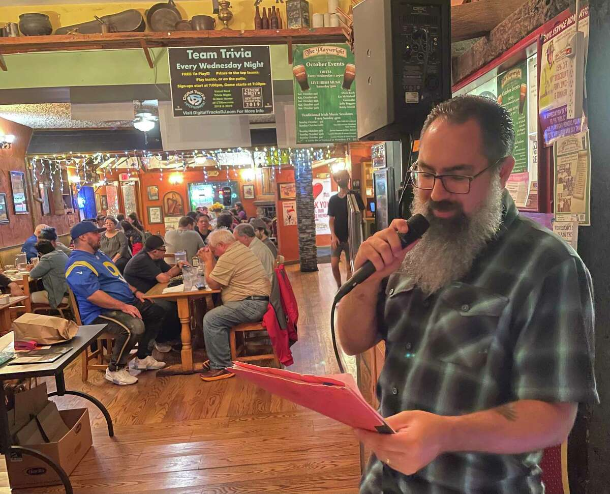 Anthony Apuzzo reads off trivia questions at The Playwright in Hamden Oct. 13, 2021.