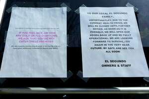 Restaurants in along Washington Street including El Segundo post signs for closings or reduced service due to Corona Virus outbreak Wednesday, March 18, 2020, in South Norwalk, Conn.