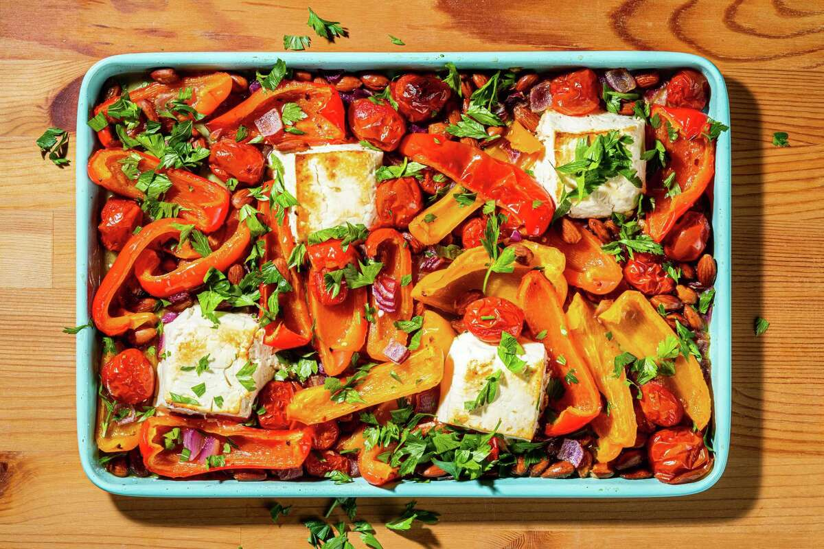 Romesco-Inspired Sheet Pan Feta With Peppers and Tomatoes.