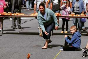 Contestants in the bagel triathlon at this year's Bagel Festival, which inlcudes rolling, stacking and throwing bagels. The annual festival draws thousands of visitors and is a much-needed and appreciated economic boost to Monticello.