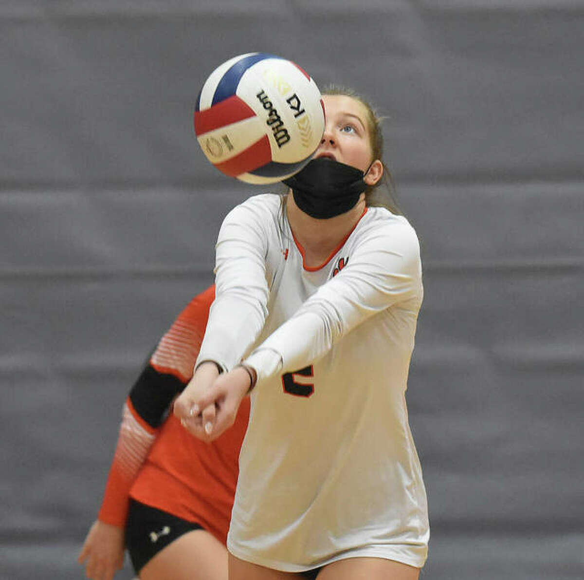 Edwardsville's Kaitlyn Conway keeps the volley alive during the second set against the Alton Redbirds on Tuesday in Alton.