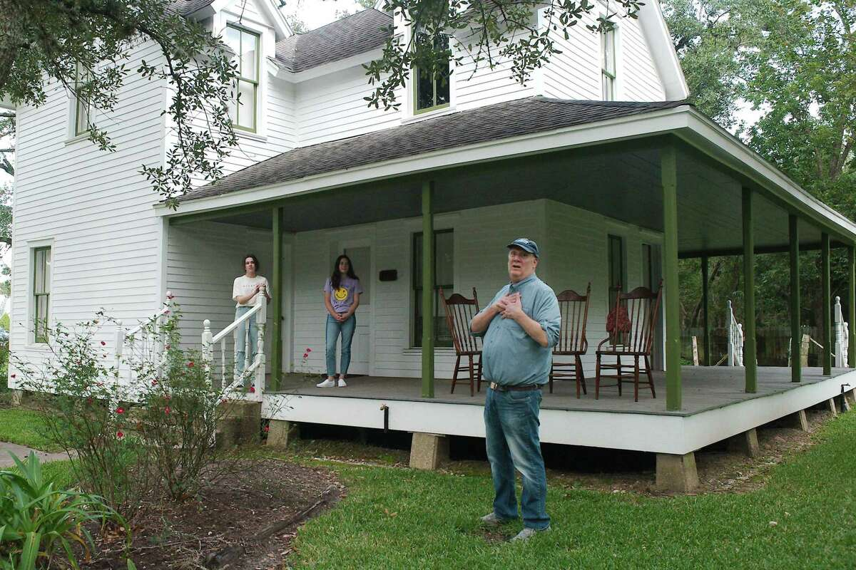 """Friendswood City Council member Steve Rockey describes details of a Oct. 30 """"Histor-Ween"""" event to Friendswood High School volunteer actors Isabelle Bartlett and Nathalie Larson. The event will start with a short play about a sensational 1870s murder that written by Rockey and will be presented on the porch of the historic Perry House Museum."""