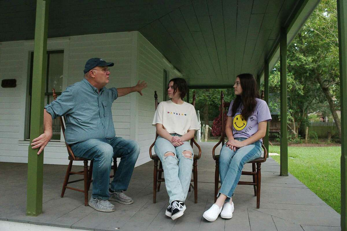 """Steve Rockey discusses plans for this year's """"Histor-Ween"""" with Friendswood High School volunteer actors Isabelle Bartlett and Nathalie Larson. The event will include a short play on the porch of the Perry House Museum and presentations by actors in a cemetery that relate the lives of early residents."""