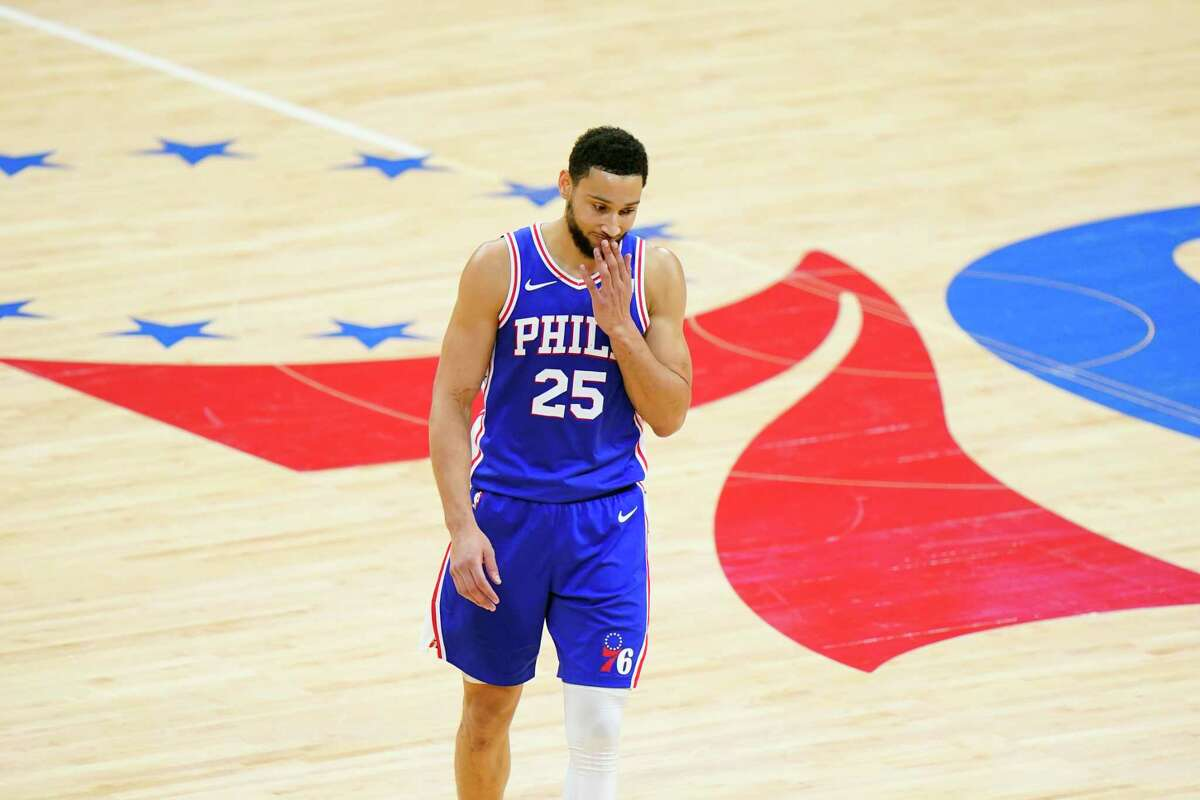 Philadelphia 76ers' Ben Simmons wipes his face during the second half of Game 5 in a second-round NBA basketball playoff series against the Atlanta Hawks in Philadelphia.