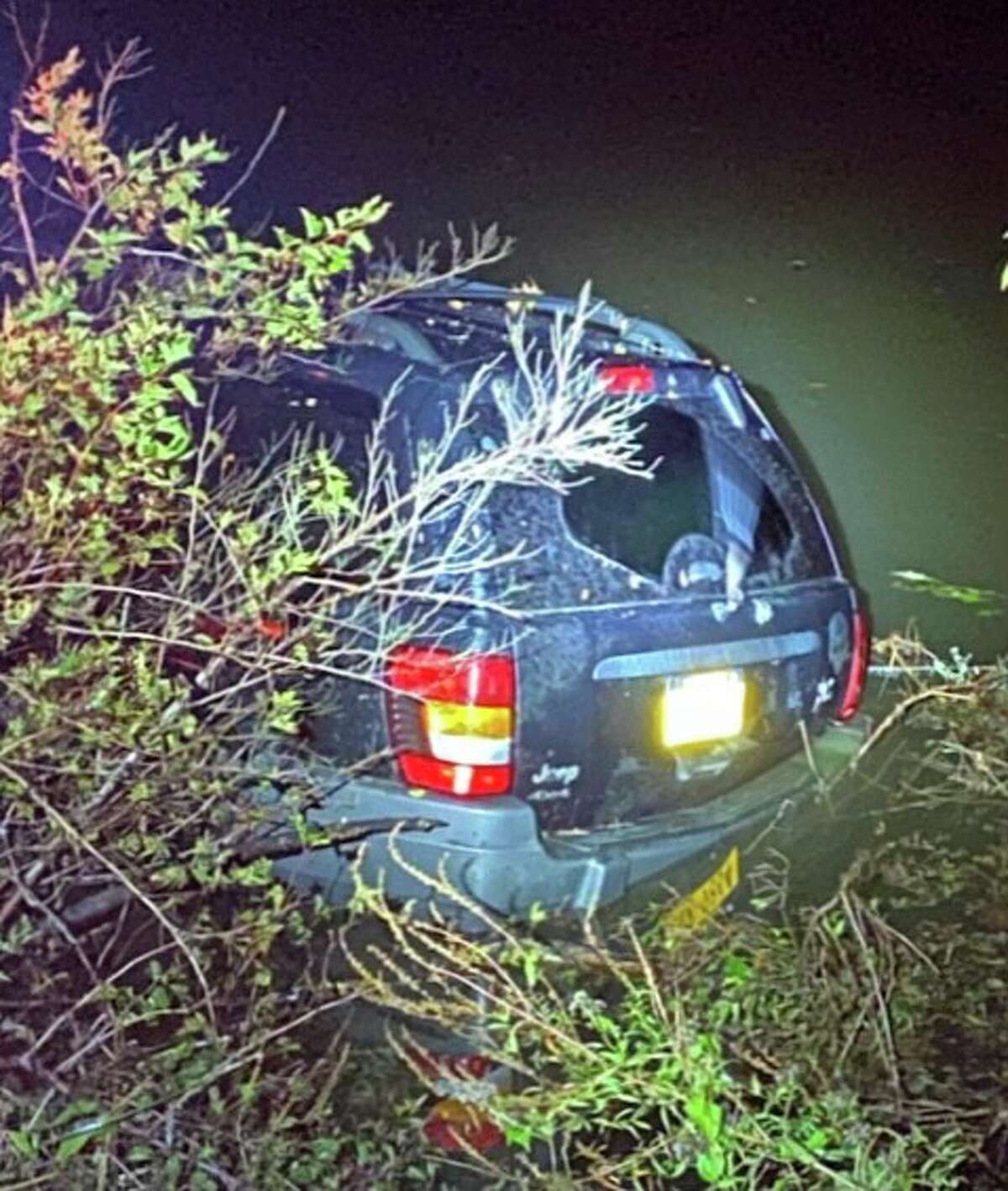 The SUV allegedly used by a Hudson man to flee police was partially submerged in the Hudson River Tuesday night.