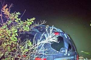 The SUV allegedly used by a Hudson man to flee police lays in the Hudson River Tuesday night.