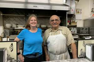 John Puglisi, right, opened the Big Tomato on Main Street in Poughkeepsie over 40 years ago. Today, it often sees a full house, with long-time waitresses like Amanda Dalvo, left, serving both regulars and out-of-towners.