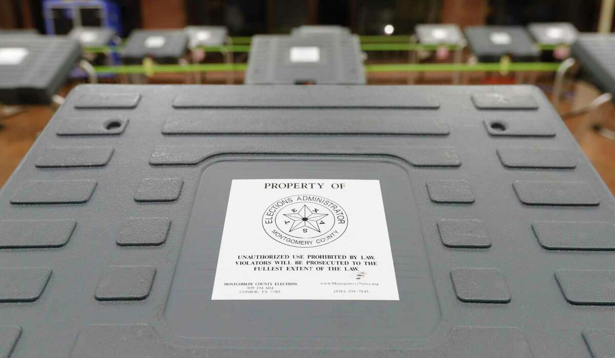 Voting machines are seen at the South Montgomery County Community Center on July 2, 2020, in The Woodlands. Early voting begins Monday and voters in The Woodlands will decide if the special purpose district they call home will keep its unique governance or become a city.