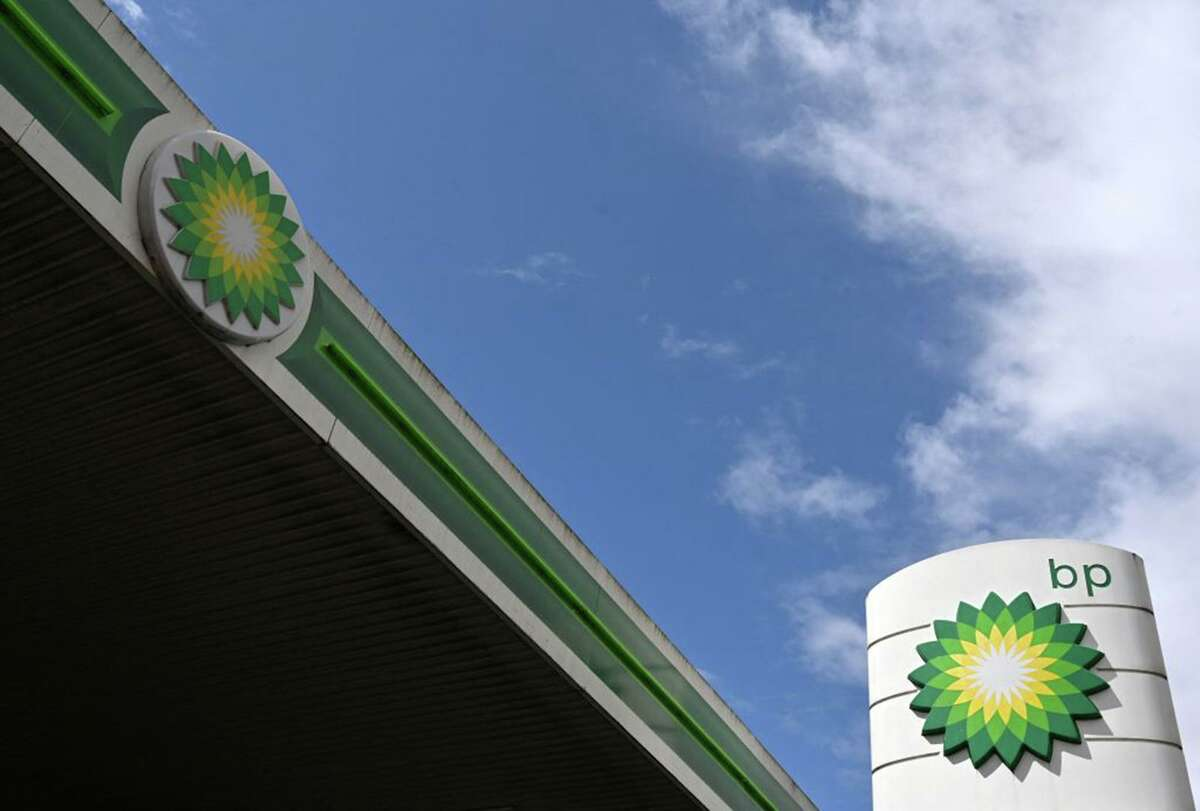 BP logos are pictured at a BP petrol and diesel filling station in north London on May 12, 2021.