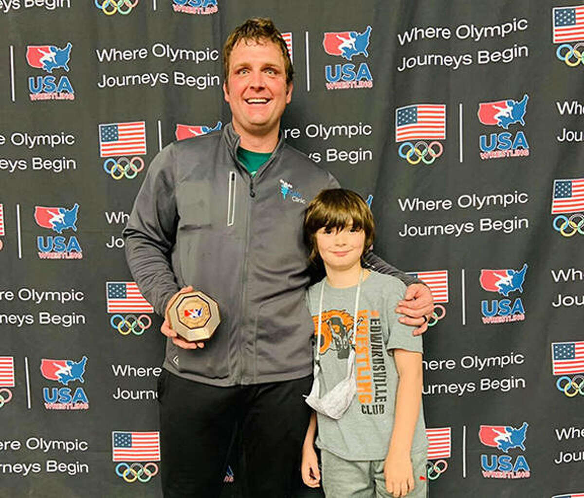 Dr. Mike Harbison, owner of iCAN Clinic in Edwardsville, with his son, Hewitt, at the Folkstyle Nationals Championships, held April 1-3 at the University of Northern Iowa in Cedar Rapids, Iowa. Harbison will wrestle for Team USA at the Veterans World Championships, set for Oct. 18-22 in Loutraki, Greece.