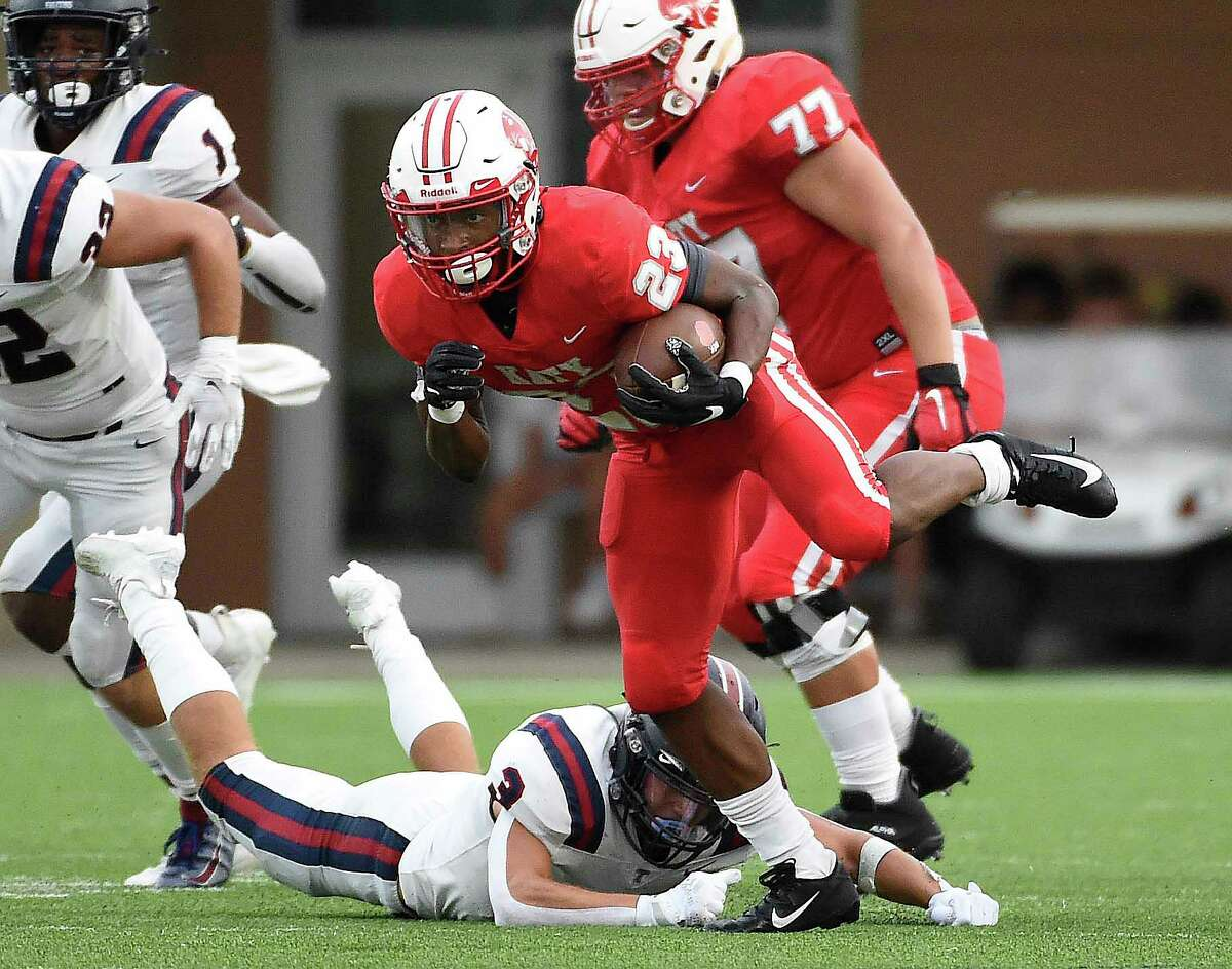 Katy running back Seth Davis (23) escapes the tackle of Tompkins linebacker Cole Binkley (3) during the first half of a high school football game, Friday, Oct. 1, 2021, in Katy.