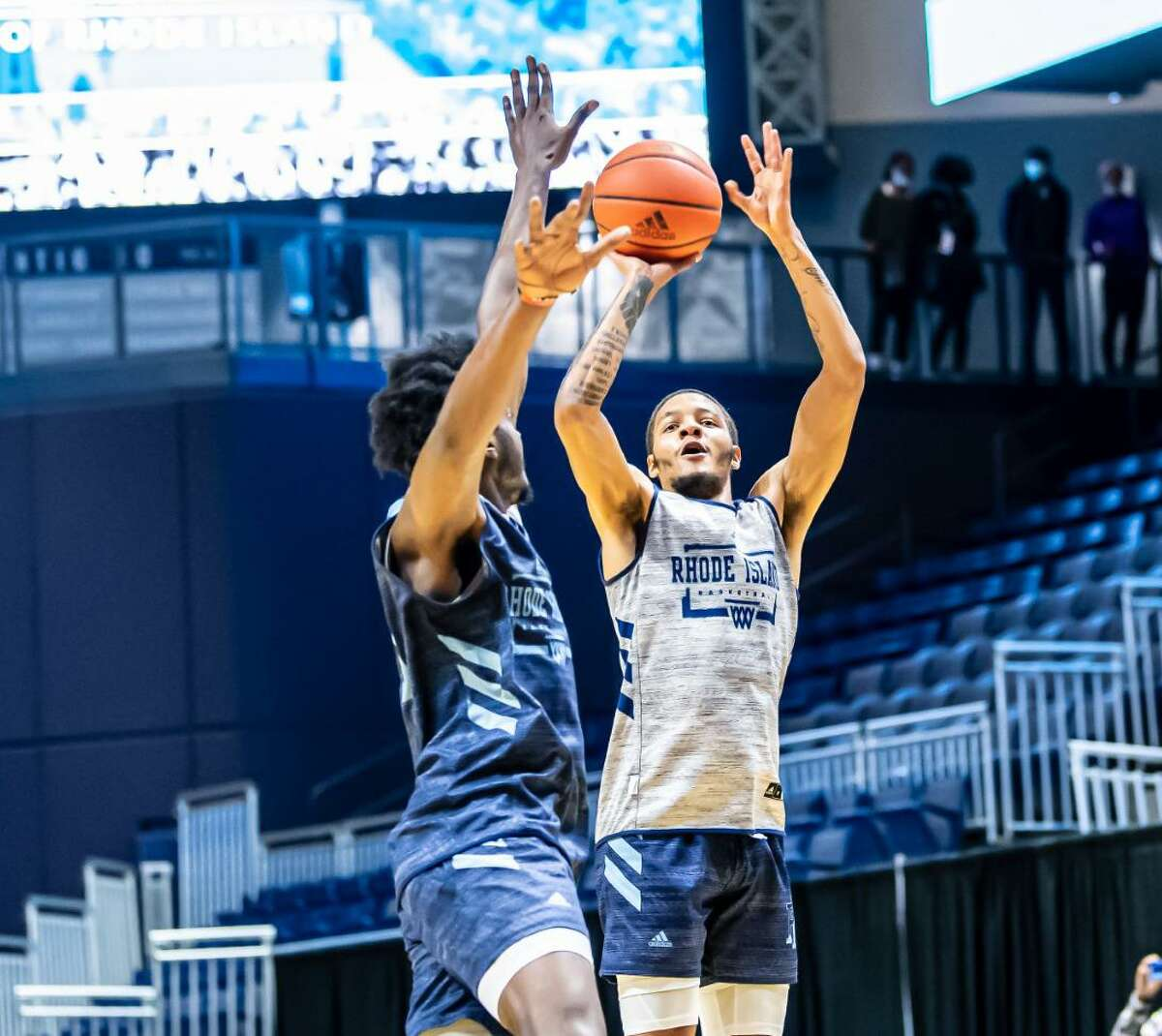 Ishmael El-Amin, son of former UConn star Khalid El-Amin, performs during the University of Rhode Island men's basketball team's Blue-White scrimmage on Saturday. El-Amin will play for URI this season as a grad student.